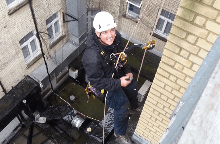 Rope access to a tall buidling to install a pigeon deterrent